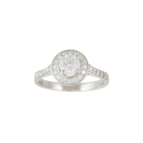 17 - A DIAMOND HALO CLUSTER RING, with GIA report stating the diamond to be 0.51ct E SI1, surrounded by d...