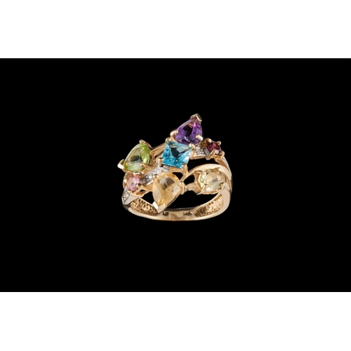 2 - A 14CT GOLD DRESS RING, set with multi-coloured stones...