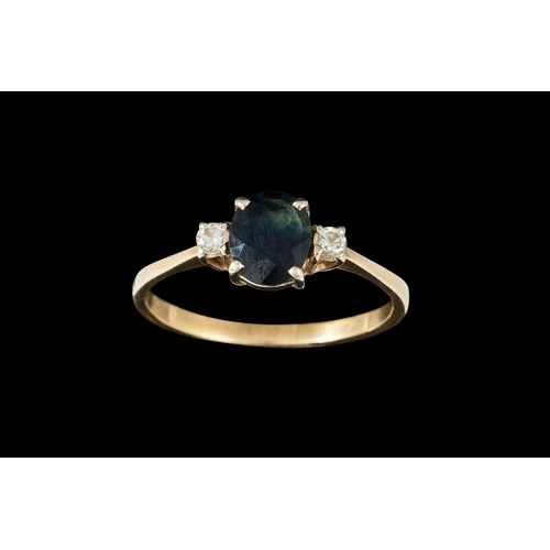 20 - A THREE STONE SAPPHIRE AND DIAMOND RING, mounted in yellow gold...