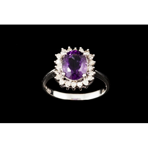39 - AN AMETHYST AND DIAMOND CLUSTER RING, with amethyst of approx. 1.58ct, mounted in 14ct white gold...