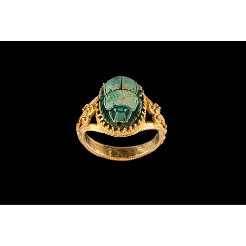 52 - A TURQUOISE SCARAB RING; together with an onyx signet ring, mounted in 9ct gold (2)...