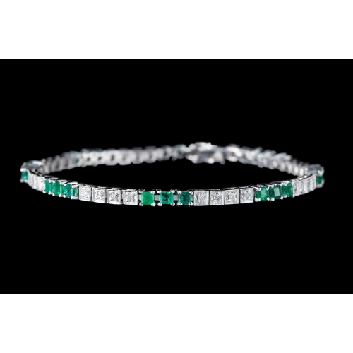 1 - AN EMERALD AND DIAMOND LINE BRACELET, with diamonds of approx. 1.45ct in total, mounted in 14ct whit...