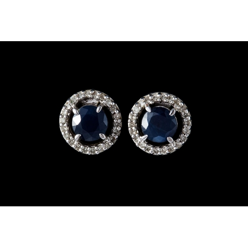 15 - A PAIR OF DIAMOND AND SAPPHIRE CLUSTER EARRINGS, mounted in white gold...