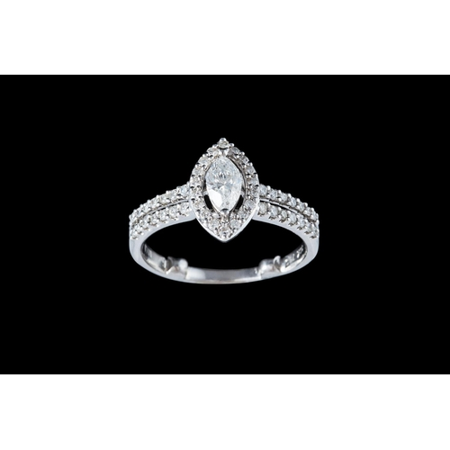 17 - A DIAMOND CLUSTER RING, with centre diamond of approx. 0.45ct E/F SI1...