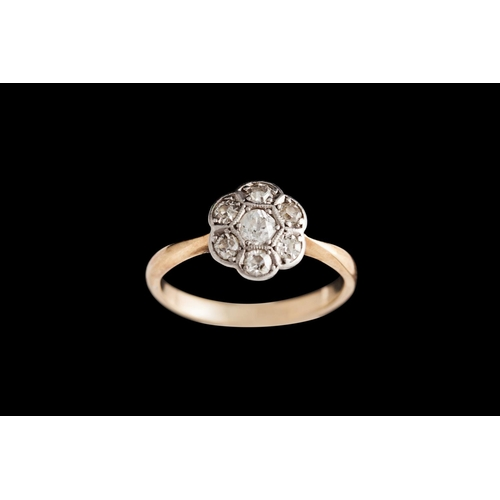 20 - AN ANTIQUE DIAMOND CLUSTER RING, mounted in 18ct yellow gold...