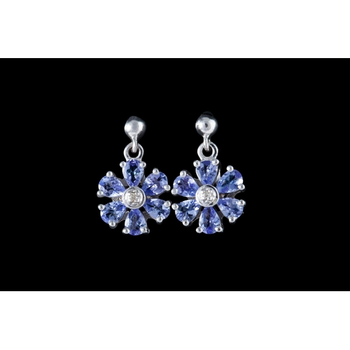 21 - A PAIR OF TANZANITE AND DIAMOND CLUSTER EARRINGS, mounted in white gold...