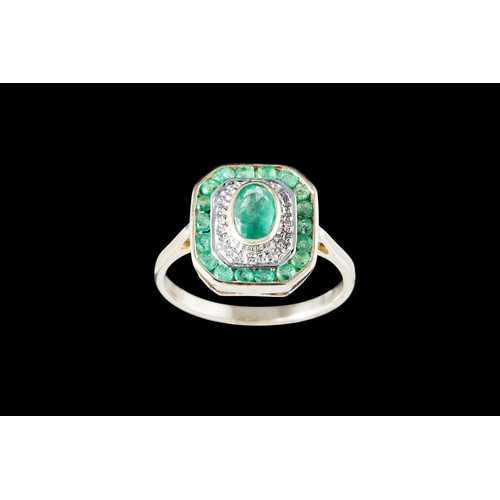 22 - AN EMERALD AND DIAMOND CLUSTER RING, mounted in 9ct gold...