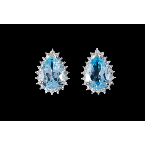 23 - A PAIR OF BLUE TOPAZ AND DIAMOND CLUSTER EARRINGS, mounted on 9ct gold...