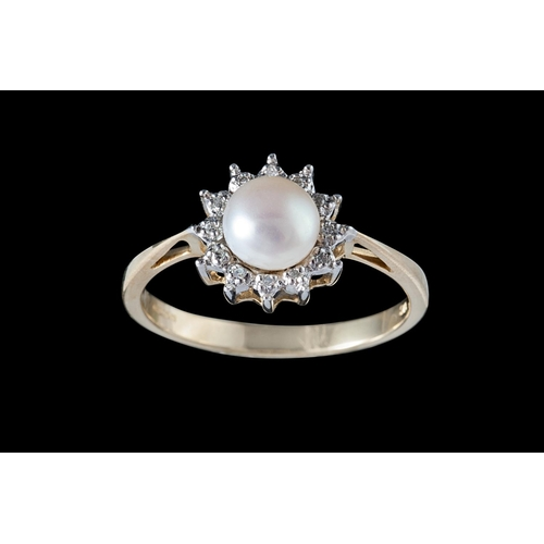 30 - A CULTURED PEARL AND DIAMOND CLUSTER RING, mounted on 9ct gold...