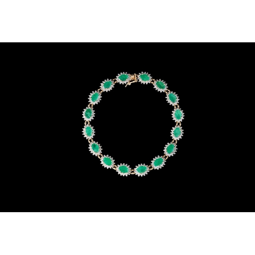 34 - AN EMERALD AND DIAMOND CLUSTER BRACELET, mounted on 18ct gold...