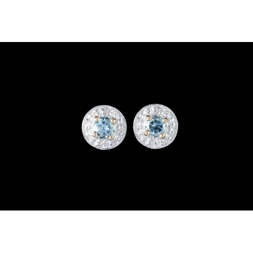 43 - A PAIR OF AQUAMARINE AND DIAMOND CLUSTER EARRINGS, mounted in 9ct white and yellow gold...