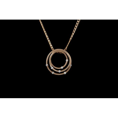 5 - A DIAMOND SET CLUSTER PENDANT, mounted in 9ct gold, on chain...