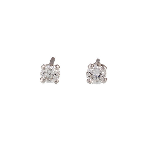 10 - A PAIR OF SOLITAIRE DIAMOND EARRINGS, of approx. 0.20ct in total...