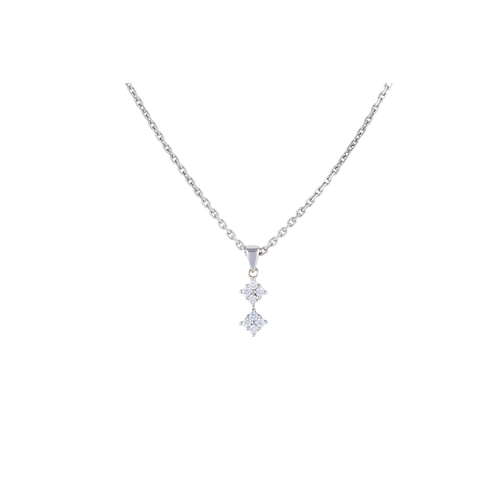16 - A DIAMOND DOUBLE CLUSTER PENDANT, on 18ct white gold chain...