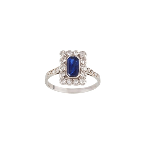 17 - A SAPPHIRE AND DIAMOND CLUSTER RING, mounted in platinum, c.1920's...