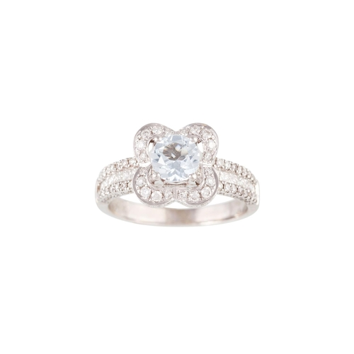 20 - AN AQUAMARINE AND DIAMOND CLUSTER RING, mounted in 18ct white gold...