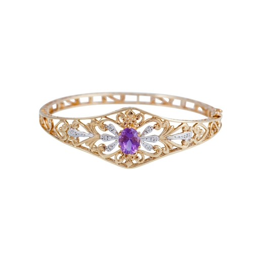 22 - AN AMETHYST AND DIAMOND BANGLE, mounted in 9ct gold...