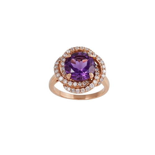 23 - AN AMETHYST AND DIAMOND CLUSTER RING, mounted in 9ct rose gold...
