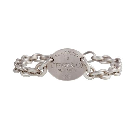 32 - A SILVER CURB BRACELET, by Tiffany & Co....