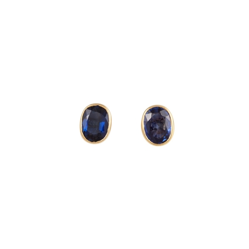 36 - A PAIR OF SOLITAIRE SAPPHIRE EARRINGS, mounted in 18ct gold...
