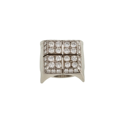 38 - A DIAMOND CLUSTER DRESS RING, mounted in 18ct white gold, size K...