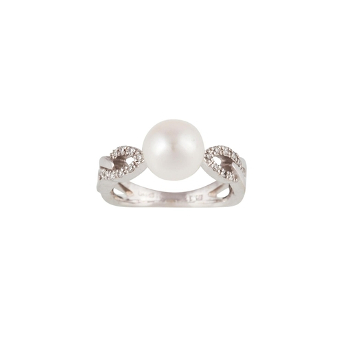 4 - A PEARL AND DIAMOND DRESS RING, mounted on 9ct gold...