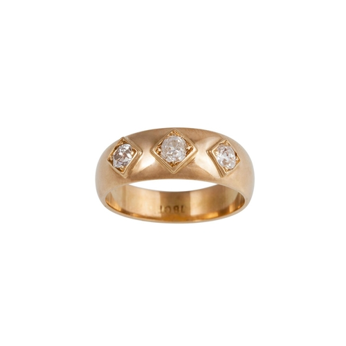 42 - A DIAMOND SET BAND RING, in 18ct yellow gold...