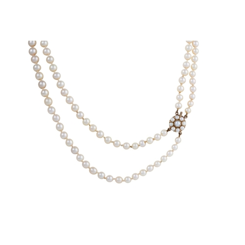 46 - A TWO ROW CULTURED PEARL NECKLACE, with 9ct gold clasp...