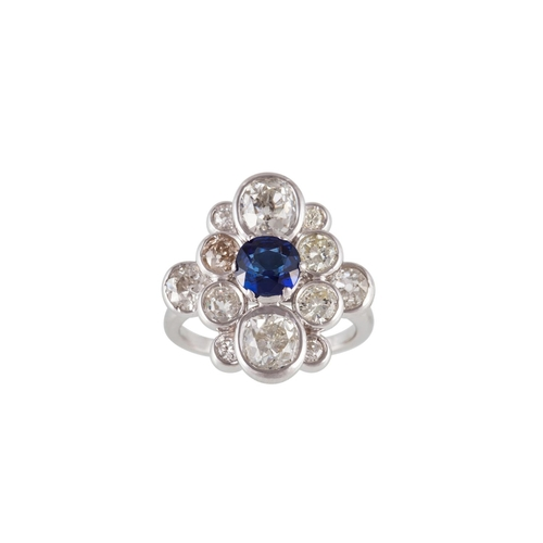 50 - A SAPPHIRE AND DIAMOND CLUSTER RING, mounted in 18ct white gold, size M...