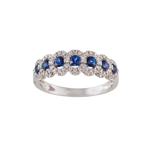 53 - A SAPPHIRE AND DIAMOND CLUSTER HALF ETERNITY RING, with sapphires of approx. 0.53ct in total, diamon...