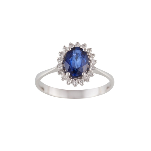 55 - A SAPPHIRE AND DIAMOND CLUSTER RING, with sapphire of approx. 1.18ct, surrounded by diamonds of appr...
