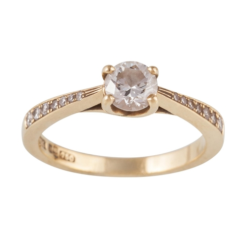 10 - A SOLITAIRE DIAMOND RING, of approx. 0.50ct, on diamond set band, in 18ct yellow gold, size J/K...
