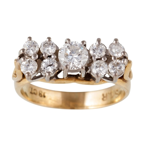 11 - A DIAMOND CLUSTER RING, of approx. 0.80ct in total, mounted in 18ct yellow gold, size I...