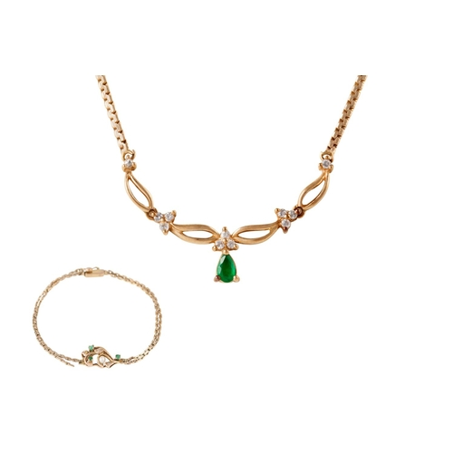 13 - AN EMERALD AND DIAMOND NECKLET, on 14ct yellow gold; together with an emerald and seed pearl bracele...