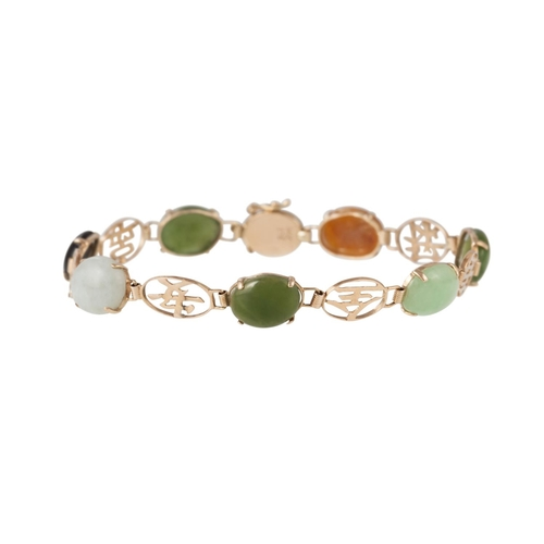 15 - A JADE AND NEPHRITE SET BRACELET, mounted in 14ct yellow gold...