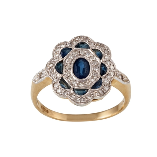 19 - A SAPPHIRE AND DIAMOND CLUSTER RING, in 18ct yellow and white gold, size M...