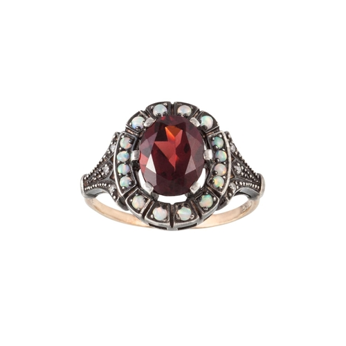 22 - A RED GEM, OPAL AND DIAMOND CLUSTER RING, mounted in 14ct yellow gold, size M...