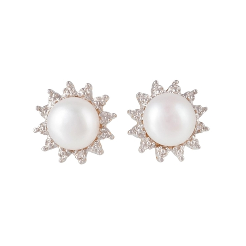 23 - A PAIR OF CULTURED PEARL EARRINGS, mounted in 9ct yellow gold...