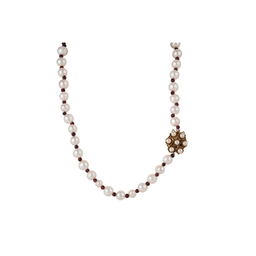 27 - A CULTURED PEARL NECKLACE, with ruby spacers, with gold clasp, 22''...