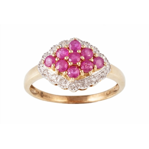 31 - A RUBY AND DIAMOND CLUSTER RING, mounted in 9ct yellow gold, size N/O...