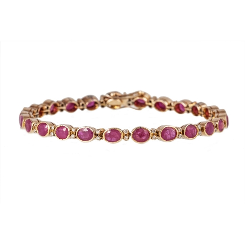 34 - A RUBY AND DIAMOND BRACELET, mounted in 9ct yellow gold...