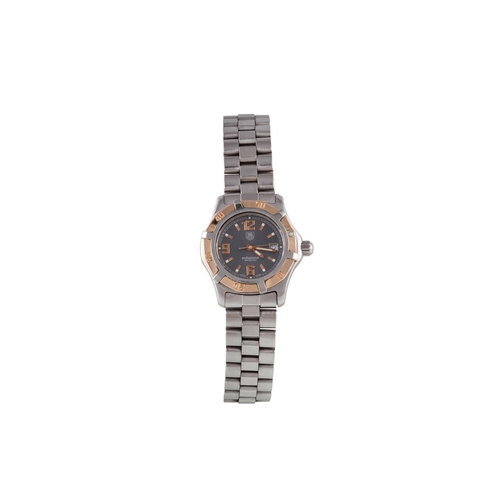 37 - A LADIES BIMETAL TAG HEUER PROFESSIONAL 200M WRIST WATCH, with date, boxed...