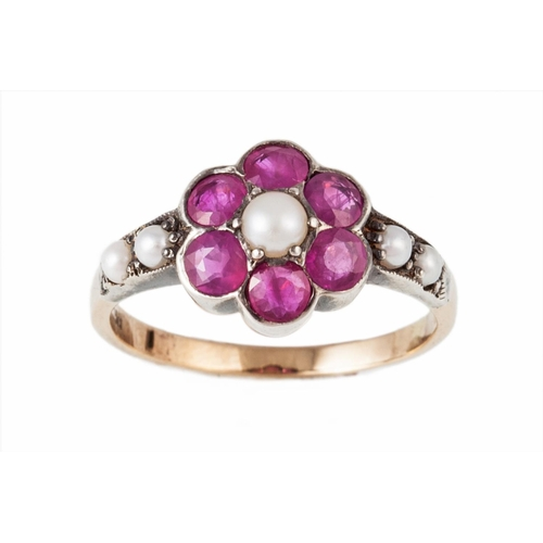 39 - A RUBY AND SEED PEARL FLORAL CLUSTER RING, mounted in 15ct yellow gold, size N...