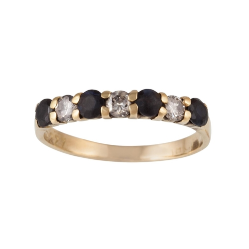 4 - A SEVEN STONE SAPPHIRE AND DIAMOND RING, mounted on 18ct gold...