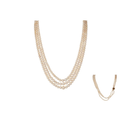 42 - A TRIPLE ROW CULTURED PEARL NECKLACE, on 9ct gold clasp...