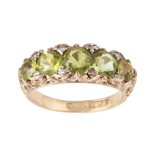43 - A FIVE STONE PERIDOT RING, set with diamonds, mounted on 18ct gold, size L/M...