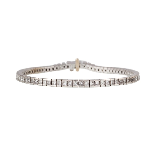 45 - A DIAMOND LINE BRACELET, of approx. 4.32ct in total, mounted in 18ct white gold...