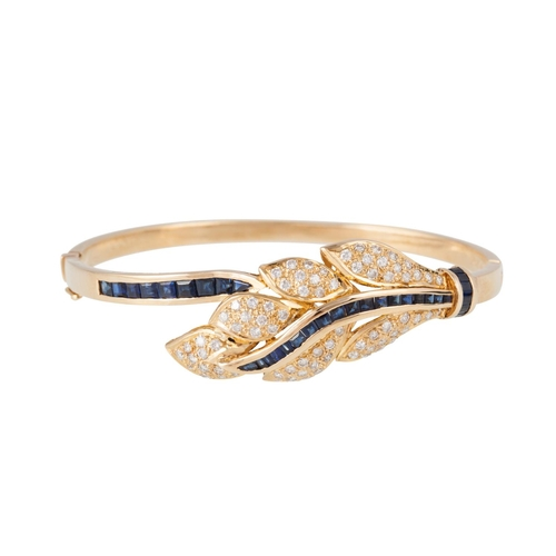 56 - A DIAMOND AND SAPPHIRE BANGLE, modelled as a leaf, pavé set with diamonds, channel set baguette sapp...