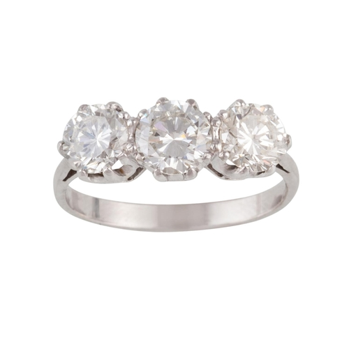 59 - A DIAMOND THREE STONE RING, with three round brilliant cut diamonds of approx 2.90ct in total, G/H V...