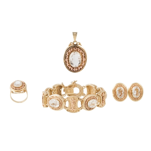 14 - A SUITE OF CRYSTAL JEWELLERY comprising of a pendant, bracelet, earrings and ring mounted in 14ct go...